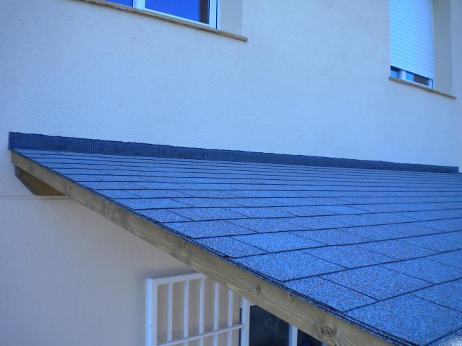 Teja asf ltica materiales cat logo garden house madera for Cubiertas para techos de casas